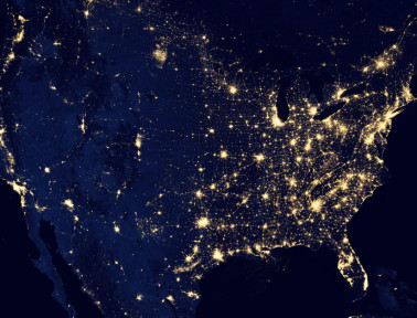 A shot of the Unites States at night. The string of lights running parallel to the eastern seaboard (far right) are major cities along The Fall Line. (Image: NASA)